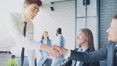 Man shaking hands at a job interview
