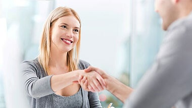 Woman shaking hands with man